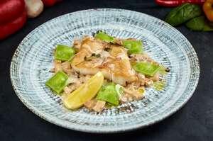Смажений судак з бiлими грибами у трюфельному соусi та равiолiнi з картоплею