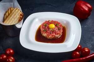 Тартар з тунця, лосося, креветок з соусом Понзу